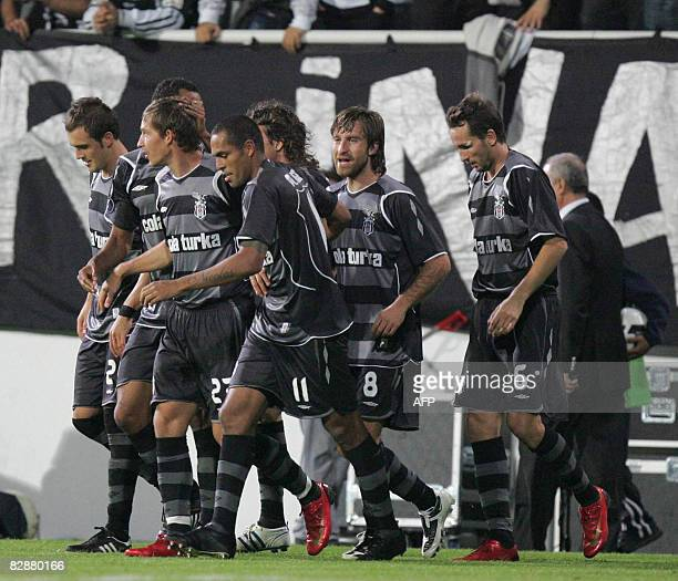 Besiktas players celebrate their goal against Metalist Kahrkiv during their UEFA Cup first round match at Inonu Stadium in Istanbul, on September 18,...