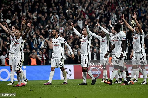 Besiktas' players gesture after the UEFA Champions League Group B football match between Besiktas Istanbul and Benfica Lisbon on November 23 at the...