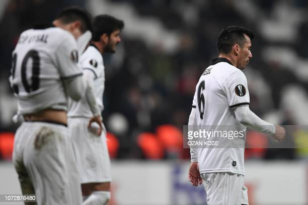 Besiktas' players leave the pitch after being defeated at the end of the UEFA Europa League Group I football match between Besiktas JK and Malmo FF...