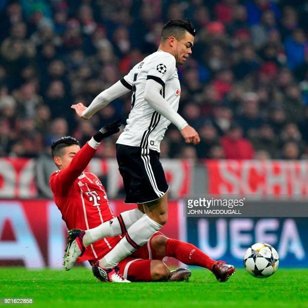 Besiktas' Portuguese defender Pepe and Bayern Munich's Colombian midfielder James Rodriguez vie with the ball during the UEFA Champions League round...