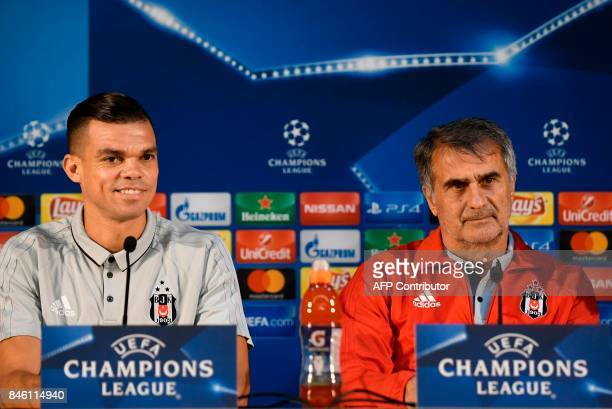 Besiktas' Portuguese defender Pepe and Besiktas' coach Senol Gunes give a press conference on the eve of the UEFA Champions League Group G football...