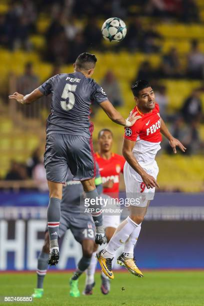 Besiktas' Portuguese defender Pepe and Monaco's Colombian forward Radamel Falcao go for a header during the UEFA Champions League group stage...