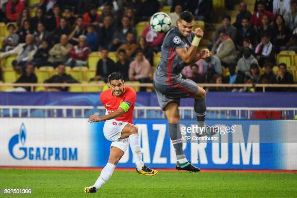 Besiktas' Portuguese defender Pepe defends against Monaco's Colombian forward Radamel Falcao during the UEFA Champions League group stage football...