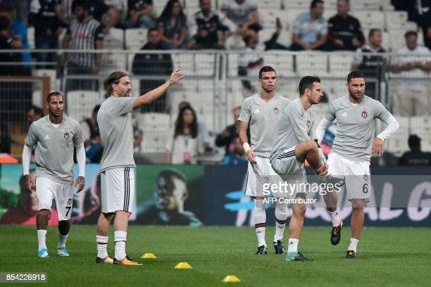 Besiktas' Portuguese defender Pepe Portuguese midfielder Ricardo Quaresma Serbian defender Dusko Tosic and teammates warm up before the start of the...