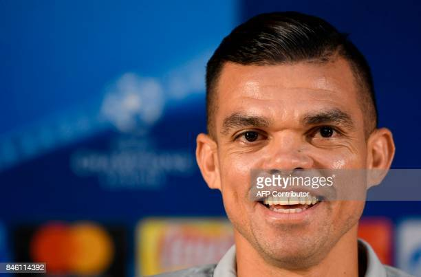 Besiktas' Portuguese defender Pepe smiles during a press conference on the eve of the UEFA Champions League Group G football match FC Porto vs...