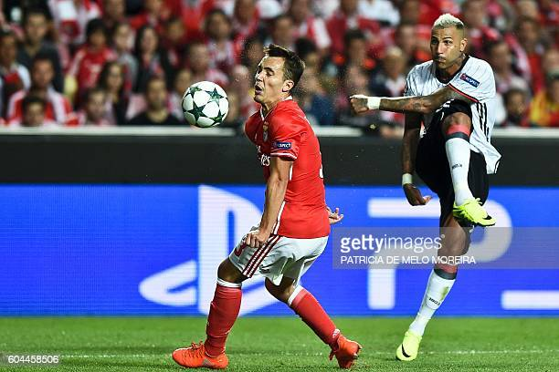 Besiktas' Portuguese forward Ricardo Quaresma hits Benfica's Spanish defender Grimaldo's face as he kicks the ball during the UEFA Champions League...