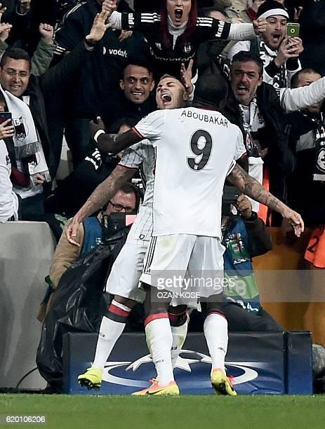 Besiktas' Portuguese midfielder Ricardo Quaresma celebrates with teammate Cameroonian forward Vincent Aboubakar after scoring a goal against Napoli...
