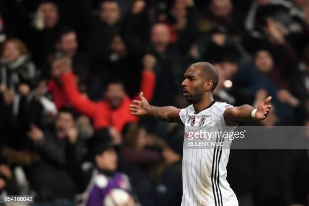 Besiktas' Ryan Babel celebrates after scoring a goal during their UEFA Europa League round of 16 second leg football match between Besiktas JK and...