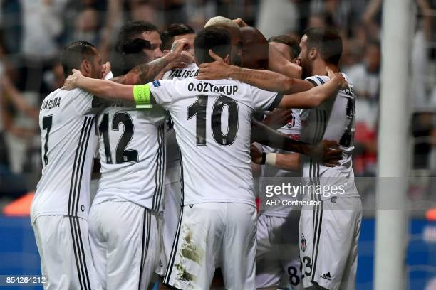 Besiktas' Ryan Babel celebrates with his team mates after scoring a goal during the UEFA Champions League group G football match between Besiktas and...