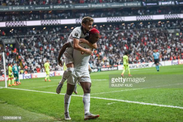 Besiktas' Ryan Babel celebrates with his teammate Adem Ljajic after scoring a goal during the UEFA European League Group I football match between...