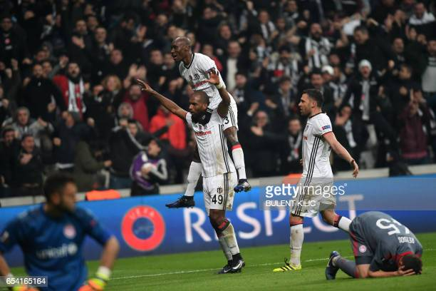 TOPSHOT Besiktas' Ryan Babel celebrates with teammates after scoring a goal during their UEFA Europa League round of 16 second leg football match...