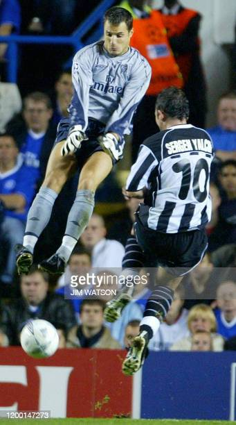 Besiktas' Sergen Yalcin kicks the ball past Chelse'a goal keeper Carlo Cudicini to score his second goal against Chelsea during their Champions...