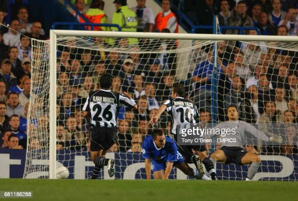 Besiktas' Sergen Yalcin scores the opening goal against Chelsea
