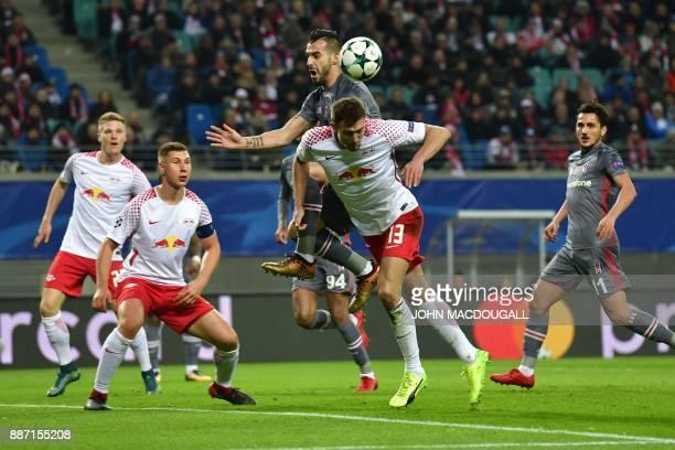 Besiktas' Spanish forward Alvaro Negredo and Leipzig's Austrian midfielder Stefan Ilsanker vie for the ball during the UEFA Champions League group G...