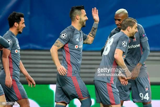 Besiktas' Spanish forward Alvaro Negredo celebrates after scoring a penalty during the UEFA Champions League group G football match RB Leipzig vs...