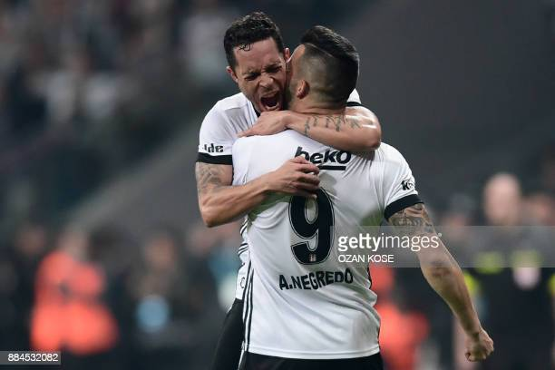 Besiktas' Spanish forward Alvaro Negredo celebrates with his teammate Brazilian defender Adriano after scoring a goal during the Turkish Super Lig...
