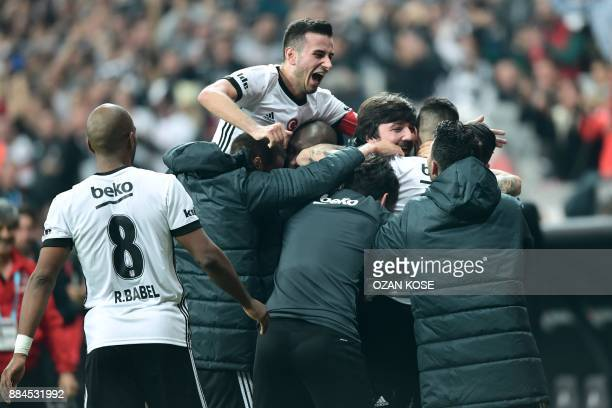 Besiktas' Spanish forward Alvaro Negredo celebrates with teammates after scoring a goal during the Turkish Super Lig football match between Besiktas...