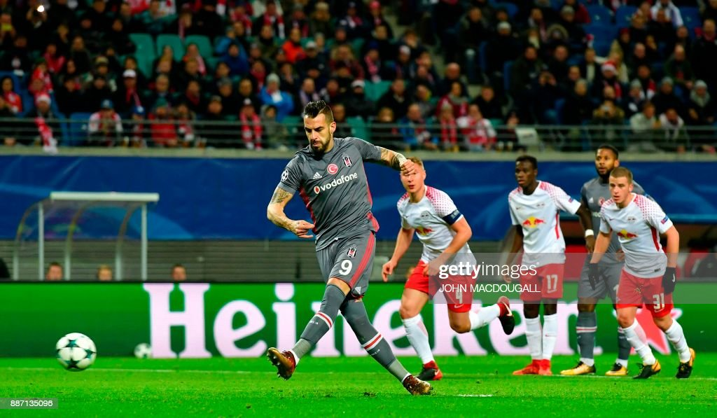 Besiktas' Spanish forward Alvaro Negredo (L) scores a penalty during the UEFA Champions League group G football match RB Leipzig vs Besiktas JK in Leipzig, eastern Germany, on December 6, 2017. / AFP PHOTO / John MACDOUGALL