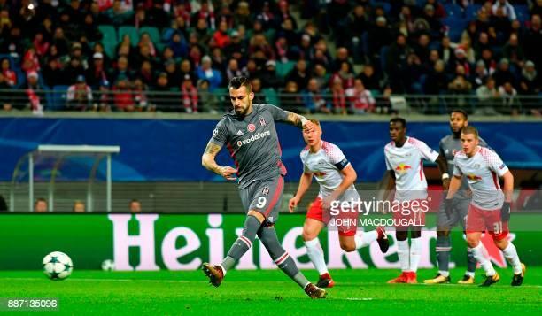 Besiktas' Spanish forward Alvaro Negredo scores a penalty during the UEFA Champions League group G football match RB Leipzig vs Besiktas JK in...