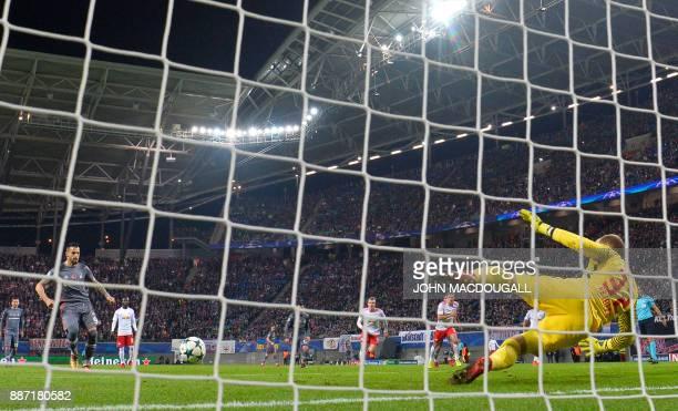 Besiktas' Spanish forward Alvaro Negredo scores a penalty during the UEFA Champions League group G football match RB Leipzig vs Besiktas in Leipzig...