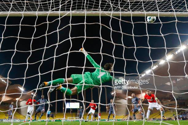 Besiktas' Spanish goalkeeper Fabricio Agosto Ramirez deflects a shot during the UEFA Champions League group stage football match between Monaco and...