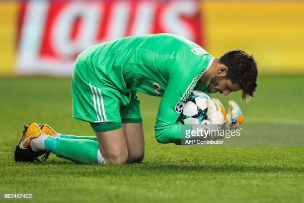 Besiktas' Spanish goalkeeper Fabricio Agosto Ramirez stops the ball during the UEFA Champions League group stage football match between Monaco and...