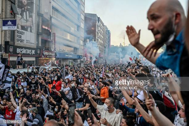 Besiktas' supporters celebrate winning Turkish Super League in Istanbul, on May 19, 2021.