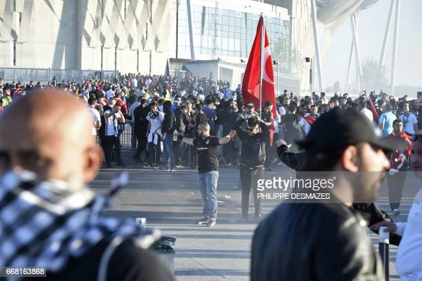 Besiktas supporters clash with French antiriot police outside of the Parc Olympique Lyonnais stadium prior to the UEFA Europa League football match...
