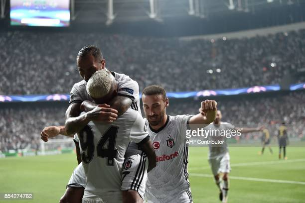 Besiktas' Talisca celebrates with team mates after scoring a goal during the UEFA Champions League group G football match between Besiktas and RB...