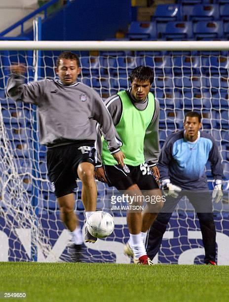 Besiktas team captain Sergen Yalcin vies for the ball during practice at Stamford Bridge stadium in London 30 September 2003 before their upcoming...