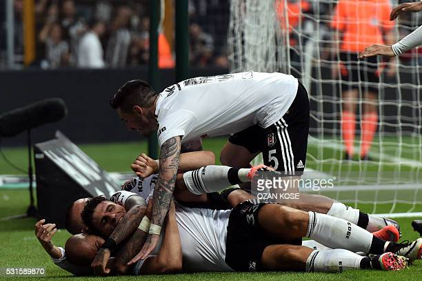 Besiktas' team celebrates after their German forward Mario Gomez scored a goal during the Turkish Spor Toto Super league football match between...