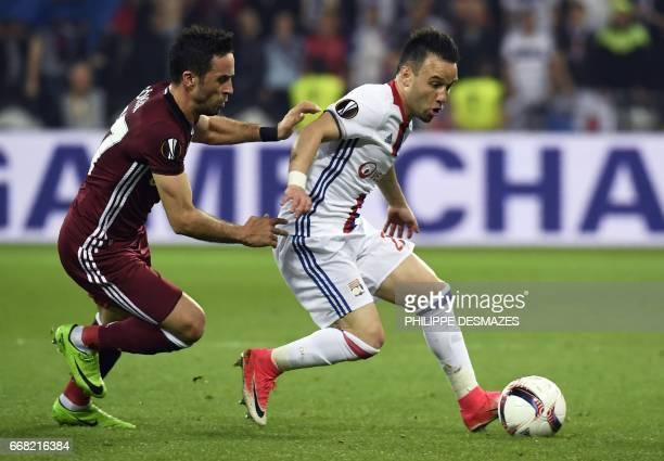 Besiktas' Turkish defender Gokhan Gonul vies with Lyon's French forward Mathieu Valbuena during the UEFA Europa League first leg quarter final...
