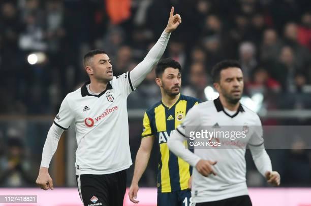 Besiktas' Turkish forward Burak Yilmaz celebrates after scoring a goal during the Turkish Super Lig football match between Besiktas and Fenerbahce on...