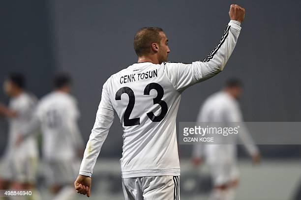Besiktas' Turkish forward Cenk Tosun celebrates after scoring a goal during the UEFA Europa League football match between Besiktas and Skenderbeu at...
