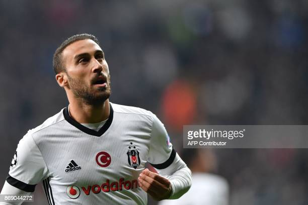 Besiktas' Turkish forward Cenk Tosun celebrates after scoring a goal during the UEFA Champions League Group G football match between Besiktas and...