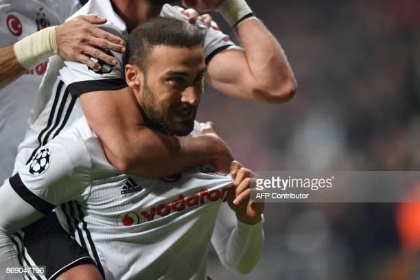 Besiktas' Turkish forward Cenk Tosun celebrates after scoring a goal during the UEFA Champions League Group G football match between Besiktas and...
