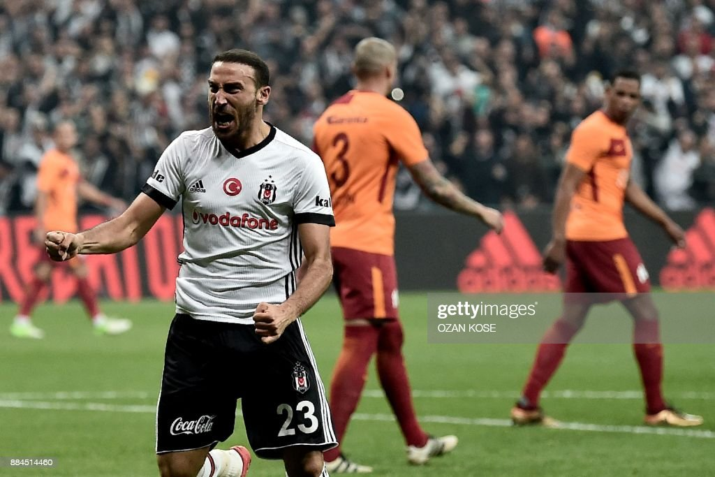Besiktas' Turkish forward Cenk Tosun celebrates after scoring a goal during the Turkish Super Lig football match between Besiktas and Galatasaray on December 2, 2017 at Vodafone Park Stadium in Ist...