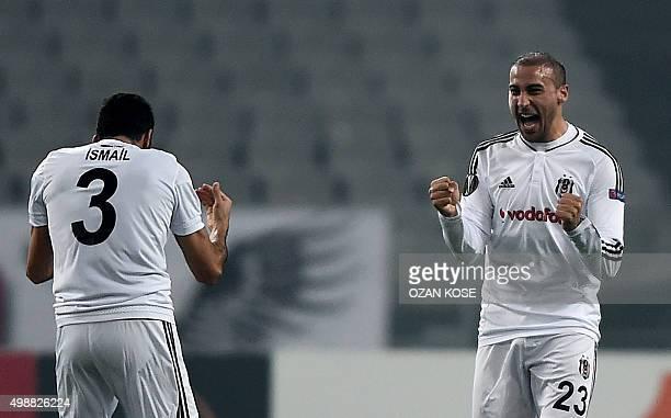 Besiktas' Turkish forward Cenk Tosun celebrates with Besiktas' Turkish defender Ismail Koybasi after scoring a goal during the UEFA Europa League...