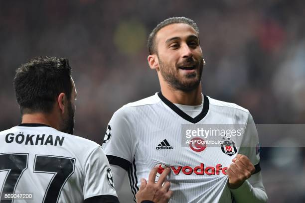 Besiktas' Turkish forward Cenk Tosun celebrates with Besiktas' Turkish defender Gokhan Gonul after scoring a goal during the UEFA Champions League...
