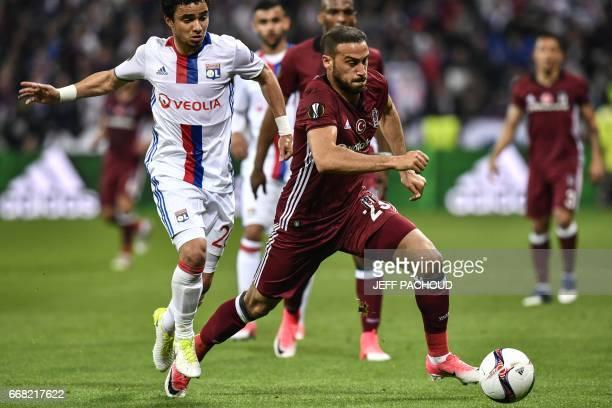 Besiktas' Turkish forward Cenk Tosun vies with Lyon's Brazilian defender Rafael da Silva during the UEFA Europa League first leg quarter final...