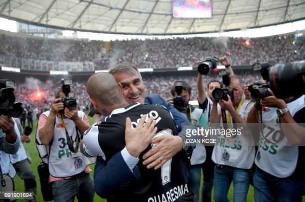 Besiktas' Turkish head coach Senol Gunes congratulates Portoguese midfielder Ricardo Queresma as players celebrate their 2016-2017 Turkish league...
