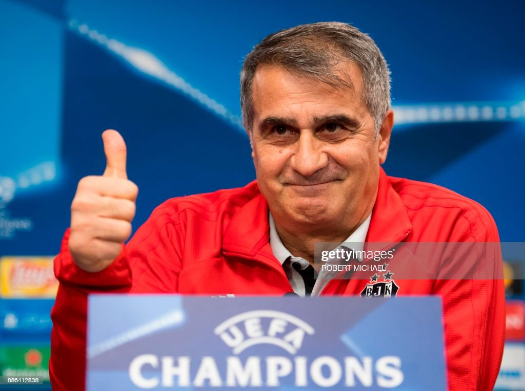 Besiktas' Turkish head coach Senol Gunes gives his thumb up during a press conference on the eve of the UEFA Champions League football match between RB Leipzig and Besiktas Istanbul in Leipzig, eastern Germany on December 5, 2017. /