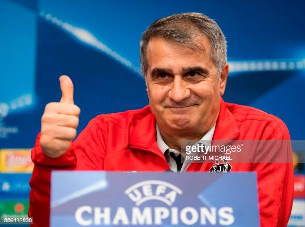 Besiktas' Turkish head coach Senol Gunes gives his thumb up during a press conference on the eve of the UEFA Champions League football match between...