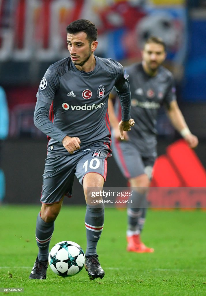 Besiktas' Turkish midfielder Oguzhan Ozyakup runs with the ball during the UEFA Champions League group G football match RB Leipzig vs Besiktas in Leipzig, eastern Germany, on December 6, 2017. / AFP PHOTO / John MACDOUGALL