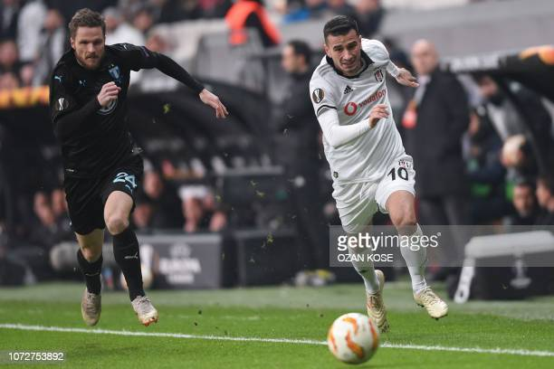 Besiktas' Turkish midfielder Oguzhan Ozyakup vies for the ball with Malmo's Danish defender Lasse Nielsen during the UEFA Europa League Group I...