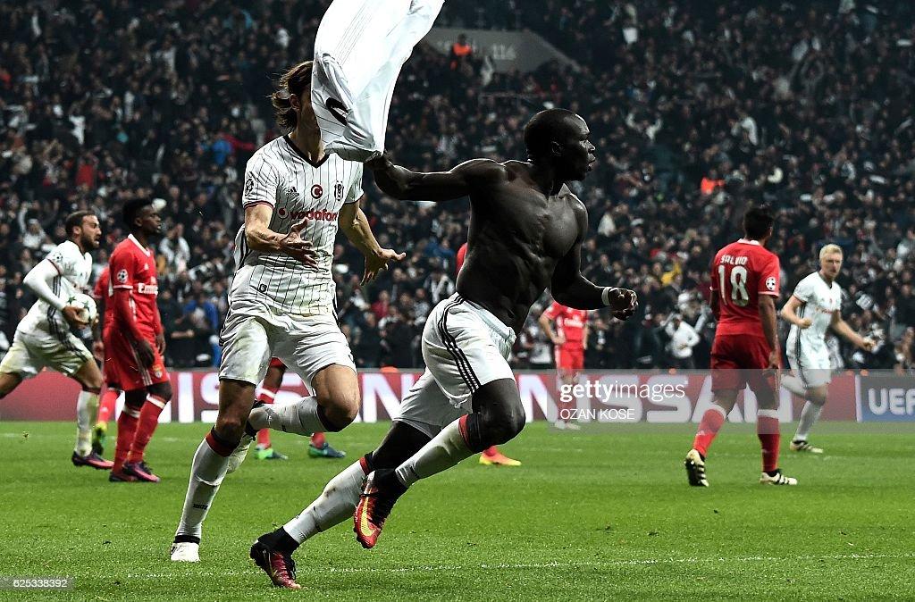 Besiktas' Vincent Aboubakar (C) celebrates after scoring a goal during the UEFA Champions League Group B football match between Besiktas Istanbul and Benfica Lisbon at Vodafone arena on November 23, 2016 in Istanbul. / AFP / OZAN