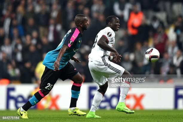 Besiktas's Cameroonian forward Vincent Aboubakar outruns Hapoel Beersheva's Brazilian midfielder William Soares during the UEFA Europa League...