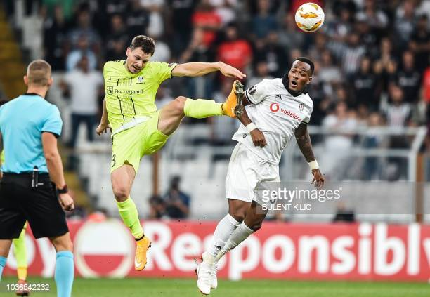 Besiktas's Cyle Larin vies for the ball with Sarpsborg's Jorgen Horn during the UEFA European League Group I football match between Besiktas and...
