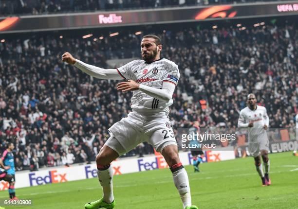 TOPSHOT Besiktas's forward Cenk Tosun celebrates scoring during the UEFA Europa League football match Besiktas vs Hapoel Beersheba on February 23...
