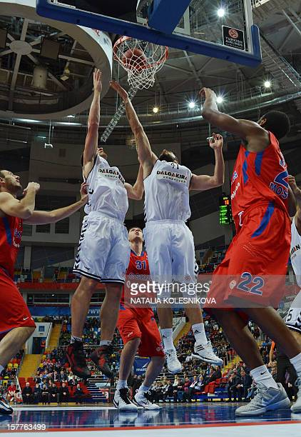 Besiktas's forward Cevher Ozer aims to score during the Euroleague Group D basketball game between Besiktas and CSKA Moscow in Moscow on December 6...